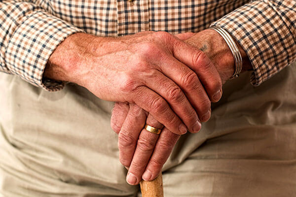 Elderly person's hands folded