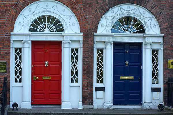 Closeup shot of red and blue front doors adjacent to each other